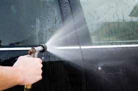 spraying hose on car